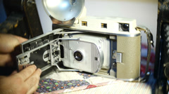 Focusing focus old polaroid camera Stock Footage