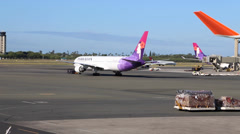 Hawaiin airplanes at the airport Stock Footage