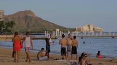Group of fit men talking at waikiki beach - diamond head Stock Footage
