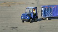 Tow Tug baggage carts Stock Footage