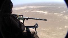 helicopter door gunner fires on enemy target (HD) - stock footage