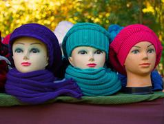 Artifical women's heads with hats - stock photo