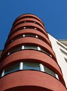 Cylinder red building taken from below - stock photo