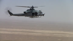 isolation shot of us marine huey helicopter over desert of afghanistan  (HD) - stock footage