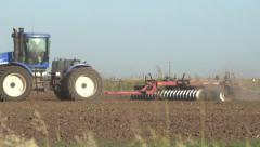 Tractor Discing Field on Farm Stock Footage
