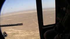 Stock Video Footage of afghanistan desert seen through open helicopter doorway  (HD)