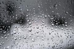 Water drops on a clear bathroom window Stock Photos