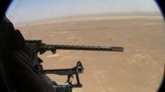 helicopter door gunner fires on enemy target in afghanistan (HD) - stock footage