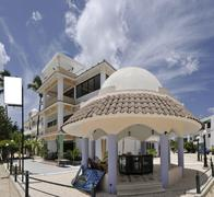 A tropical resort hotel with a billboard, ready for your advertisement! Stock Photos
