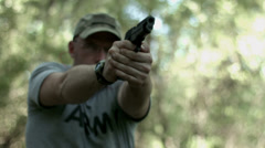 Frontal view of a man firing high caliber pistol 4K Stock Footage