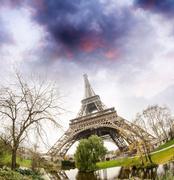 Eiffel Tower, upward view from surrounding gardens - Paris Stock Photos