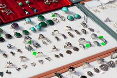 Counter with bijouterie jewelry Stock Photos