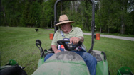 Stock Video Footage of Old Man Driving Tractor