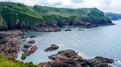 Stone Coast Of Jersey Island - stock photo