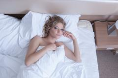 Beautiful woman top view - wake up in morning bed Stock Photos