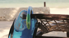 Diving mask hanging on sunbed Stock Footage