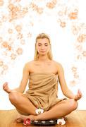 beautiful young woman meditating - stock photo
