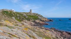 Coast And Lighthouse Jersey Island - stock photo