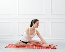 Lifestyle. beautiful girl during yoga exercise Kuvituskuvat