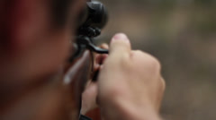 Rifle shooting shallow depth of field Stock Footage