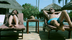 Couple relaxing on sunbed Stock Footage