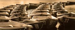 Boats arranged in a row - stock photo