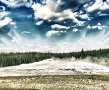 Starting eruption of Old Faithful geyser at Yellowstone National Stock Photos