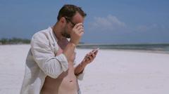Man taking selfie on the beach Stock Footage