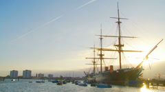 Sun hits Historic HMS Warrior, 1860 ship Stock Footage