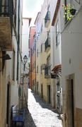Narrow street in Alfama, Portugal Stock Photos