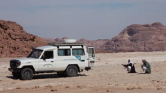 Jeep and bedouins in the Sinai desert Stock Footage