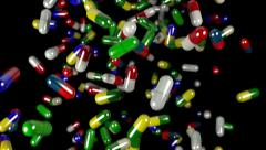 Pills drugs capsules falling slow motion closeup DOF Stock Footage