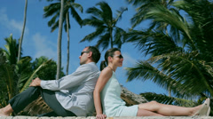 Businesspeople relaxing in exotic place Stock Footage