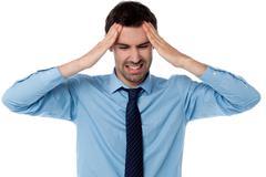 Man having severe headache Stock Photos