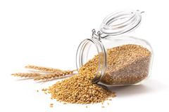 Wheat and wheat grains into a jar Stock Photos