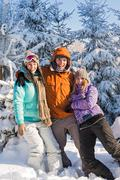 Three friends enjoy snow winter holiday mountains Stock Photos