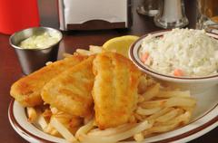 Fish and chips with coleslaw Stock Photos