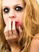 Scared girl with beautiful blond hair Stock Photos