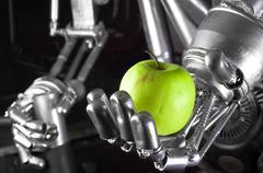 Robot hand holding green apple Stock Photos