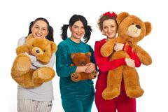 Cheerful women in pyjamas with teddy bears - stock photo