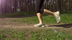 Young woman running on a rural road in the park. Sports lifestyle Stock Footage