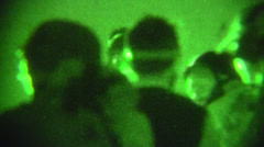 Night Vision: enemy combatant placed in van (HD) - stock footage