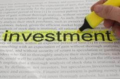 Typed text investment yellow marked Stock Photos