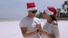 Man giving his girlfriend present for Christmas, steadycam shot Stock Footage