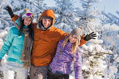 Friends enjoy winter holiday break snow mountains Stock Photos