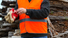 Worker donning work gloves Stock Footage