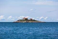 Lighthouse on a small island in the adriatic sea Stock Photos