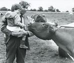Dairy farmer and son, UK, 1980s Stock Photos