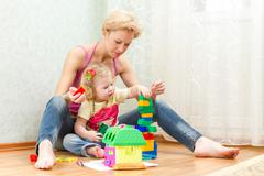 mother with a little daughter playing - stock photo