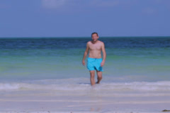 Man walking on the beach Stock Footage